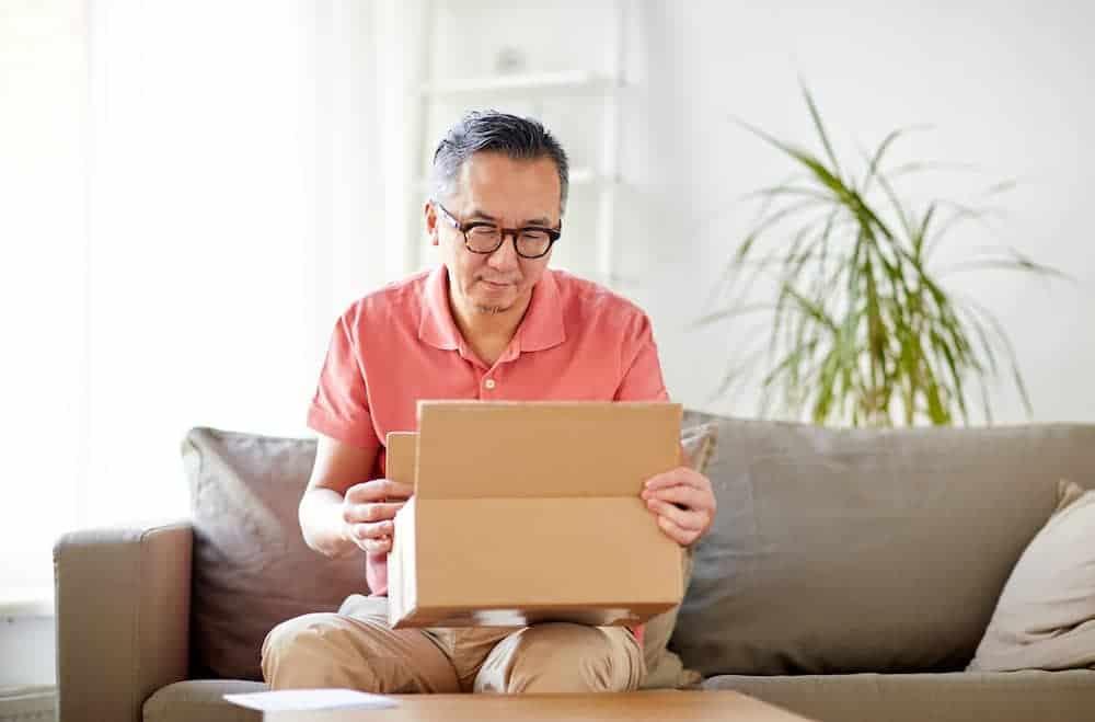 man opening parcel box at home PNRC
